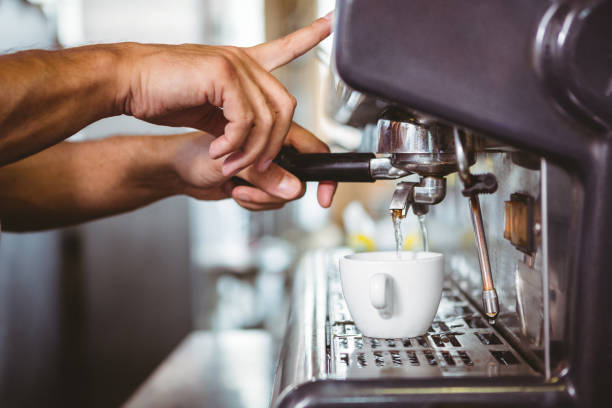 happy worker making coffee - barista making coffee stock pictures, royalty-free photos & images