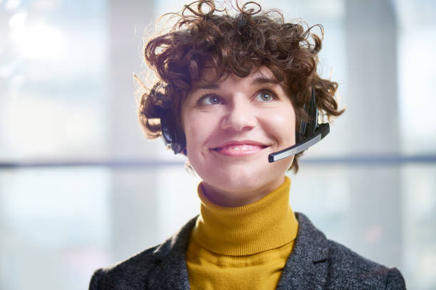 Happy worker of call center in sunlight stock photo