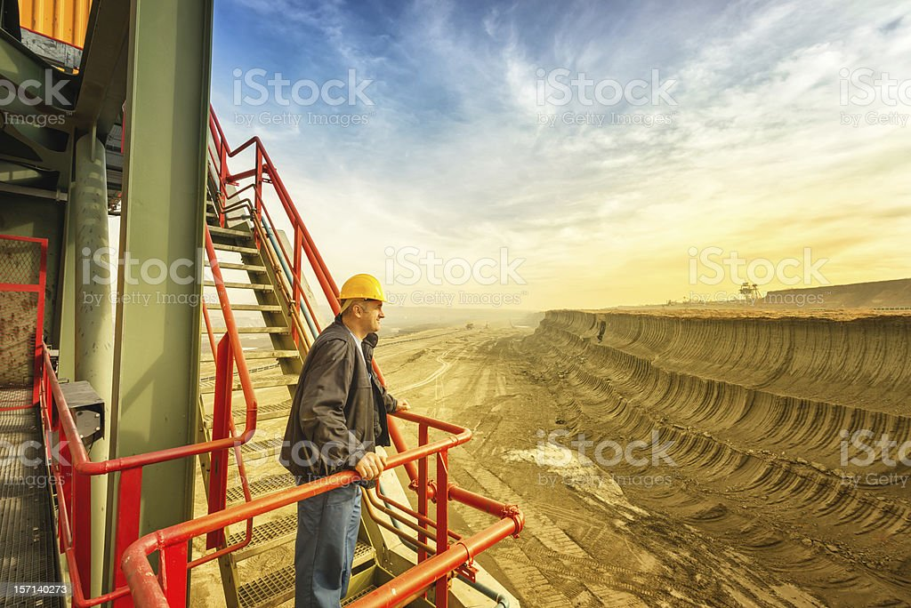 Happy worker on drill machine stock photo