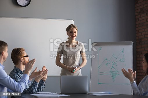 924519152 istock photo Happy workers applauding thanking businesswoman for presentation 1033950608