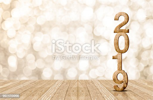 1018565666istockphoto 2019 happy year wood number in perspective room with sparkling bokeh wall and wooden plank floor.copy space for display of product or text. 992559996