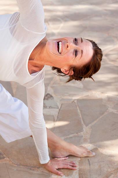 happy yoga woman - kundalini yoga stock-fotos und bilder