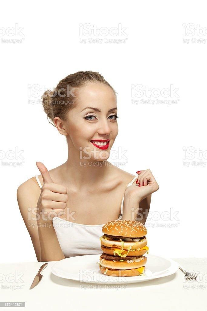 happy youn woman with a hamburger royalty-free stock photo