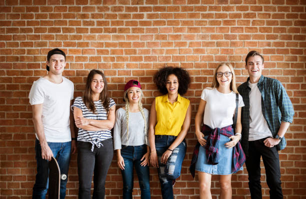 Happy young adult group of friends youth culture concept stock photo
