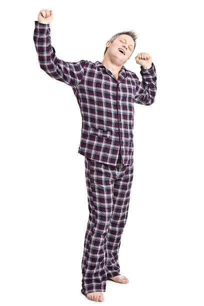 happy young adult in pyjamas stock photo