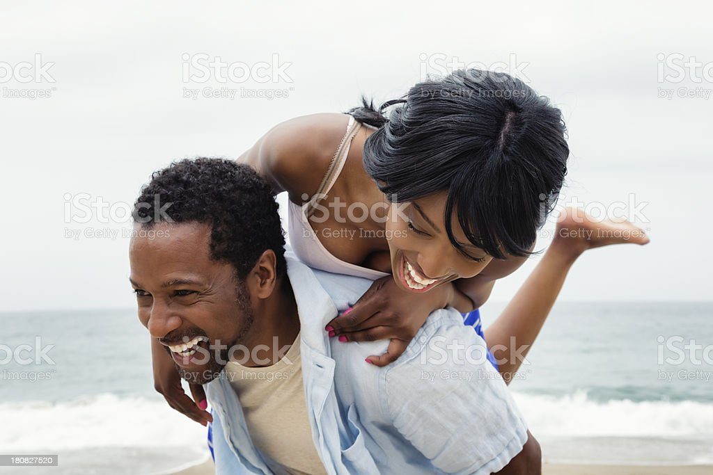 Happy Young African American Couple on Beach stock photo