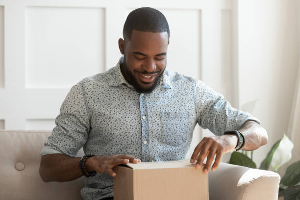Happy young african american man unboxing delivery parcel picture id1177334846?b=1&k=6&m=1177334846&s=612x612&w=0&h=zo3dsikldggcwce1fwi5gqu0z5ioosormc 4ul99l c=