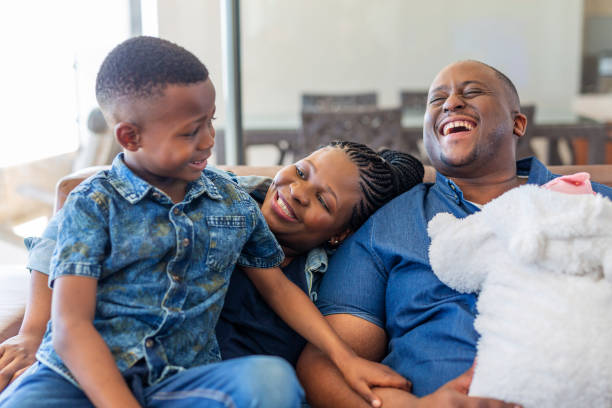 Happy Young African Family at Home stock photo