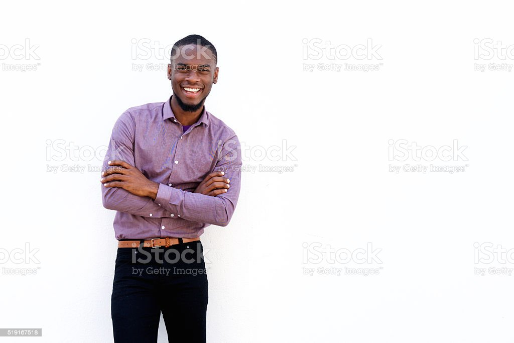 Happy young african guy with his arms crossed stock photo