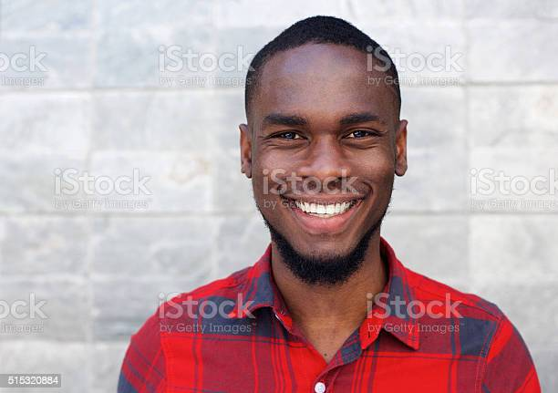 Happy young african man smiling against gray wall picture id515320884?b=1&k=6&m=515320884&s=612x612&h=hwbamd5qvgmgh zzhewhtdqil8hsbboey9cnbtaocs4=