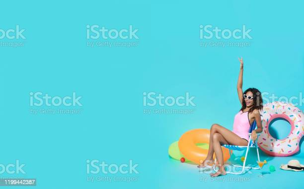 Happy young african woman dressed in swimwear gesturing say hi and picture id1199442387?b=1&k=6&m=1199442387&s=612x612&h=glggt7vbqjtfkwtyot1ua6c11selpwstab6saueggiw=
