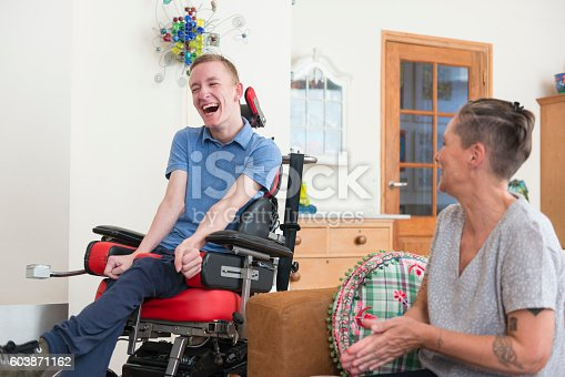 istock Happy young ALS patient with his mom 603871162