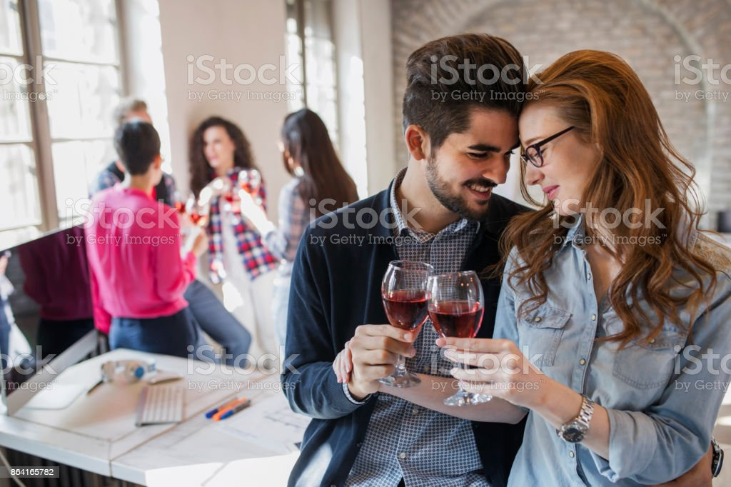 Happy young architects having break and drinking wine royalty-free stock photo