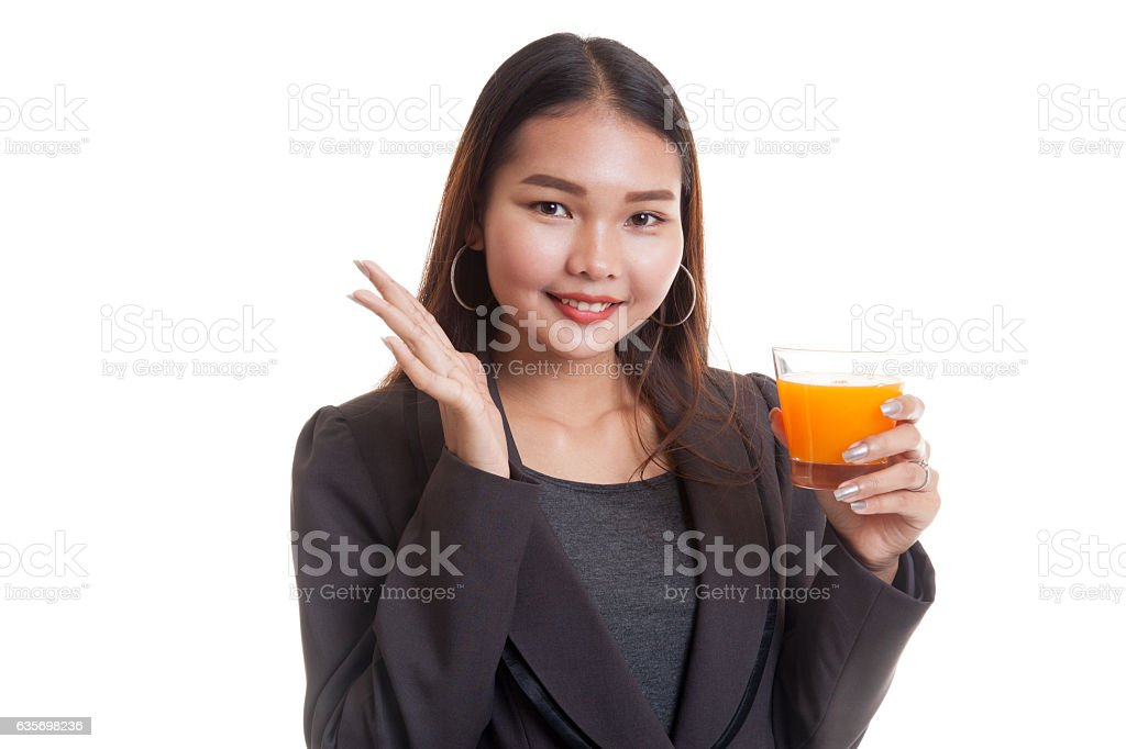 Happy Young Asian woman drink orange juice. royalty-free stock photo