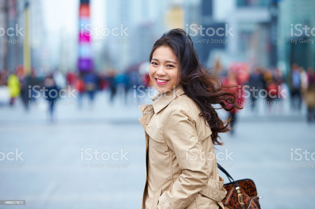 happy young asian woman in street stock photo