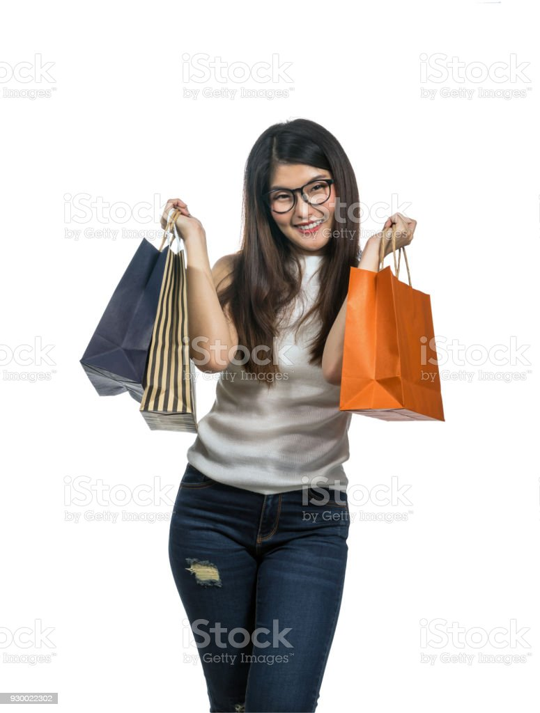 Happy young asian woman shopping in happy feeling and holding the product paper bag in white background, include clipping path stock photo