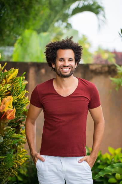 Happy Young Attractive Hispanic Man on Patio stock photo