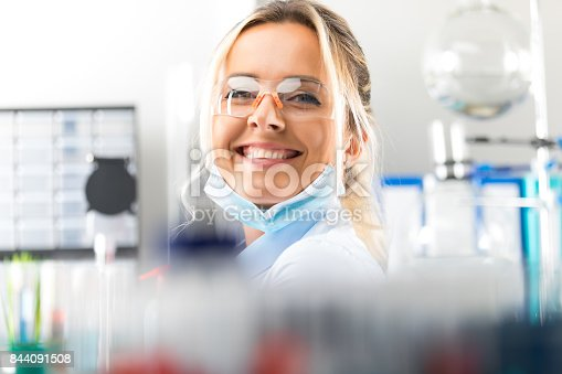 istock Happy young attractive smiling woman scientist in the laboratory 844091508