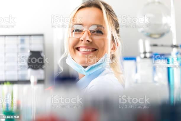 Happy young attractive smiling woman scientist in the laboratory picture id844091508?b=1&k=6&m=844091508&s=612x612&h=dsdlpshk9gkhf9qppxh u9b1qota2lji413onuwbpok=