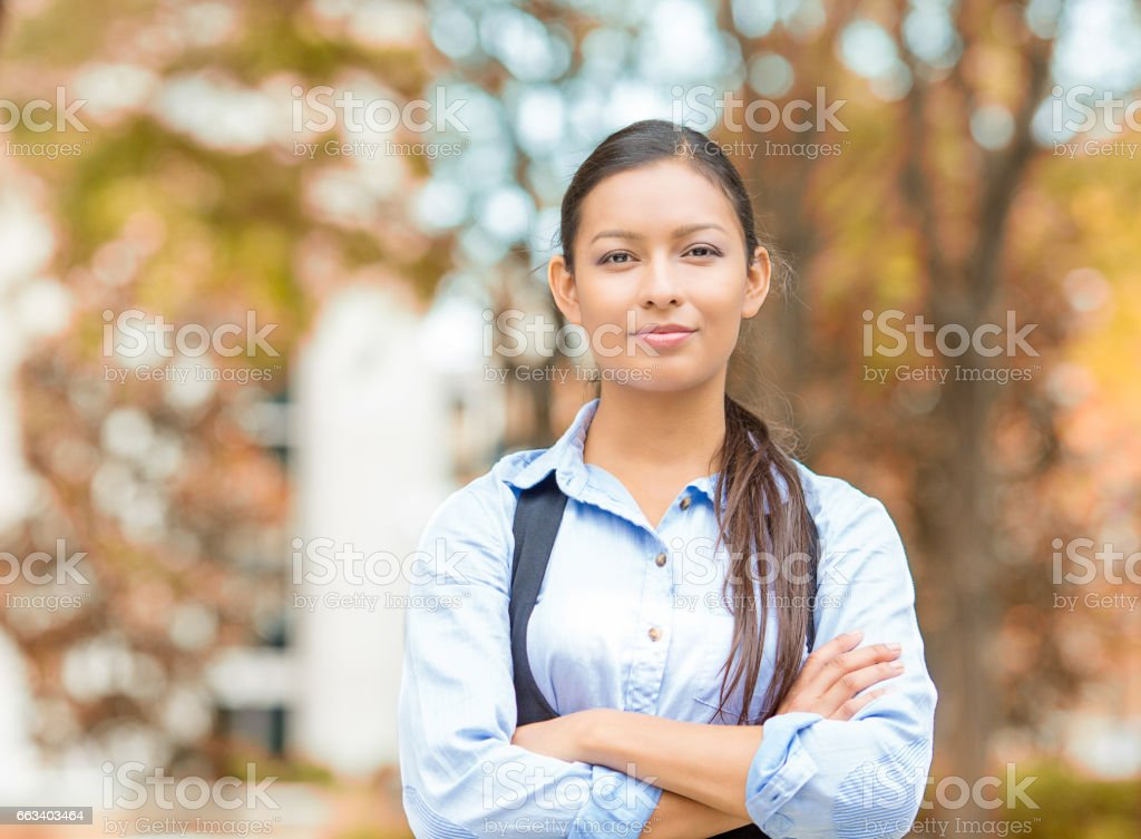 happy, young beautiful business woman professional in blue shirt smiling stock photo