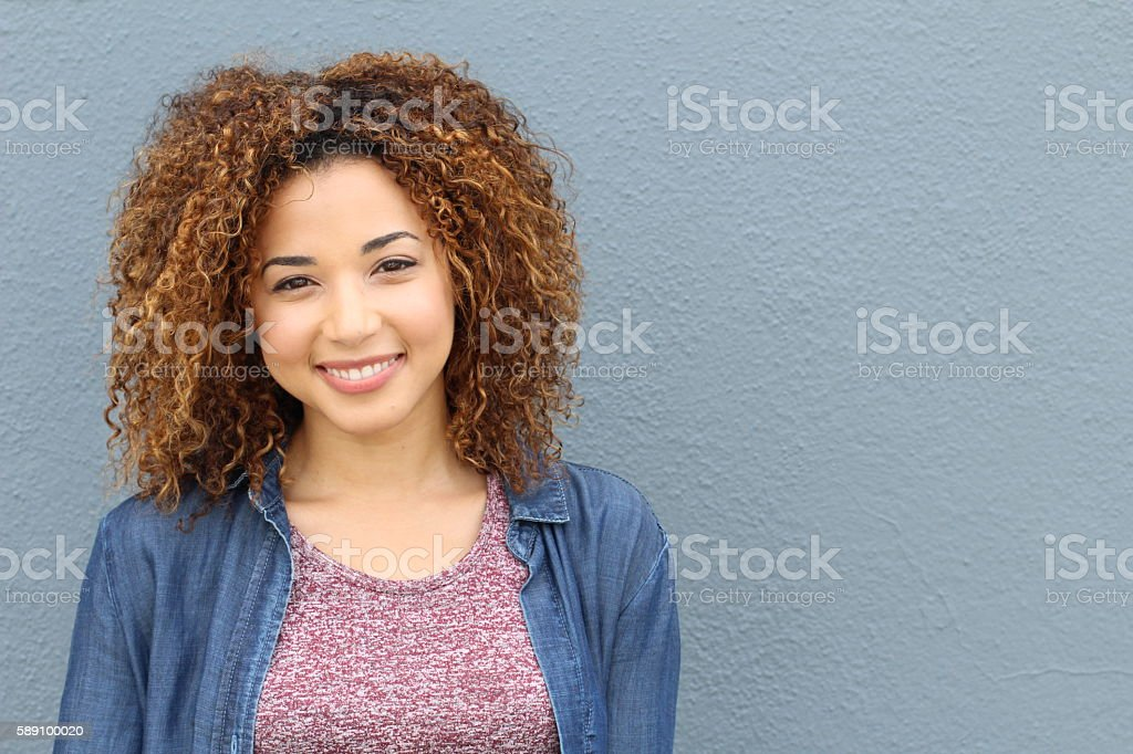 Happy young beautiful girl with copyspace stock photo