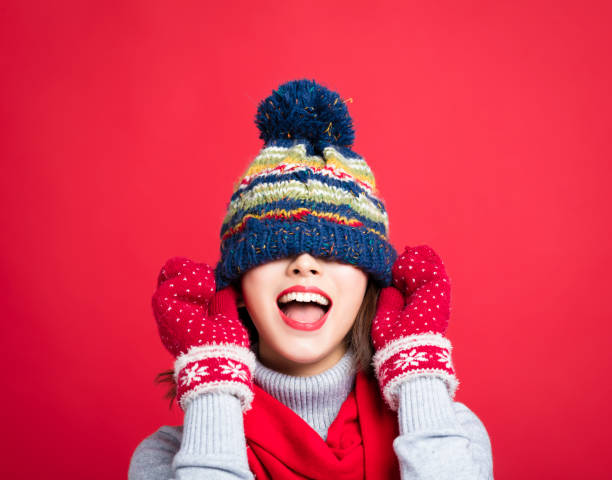 Happy Young Beautiful Woman in winter clothes Happy Young Beautiful Woman in winter clothes warm clothing stock pictures, royalty-free photos & images