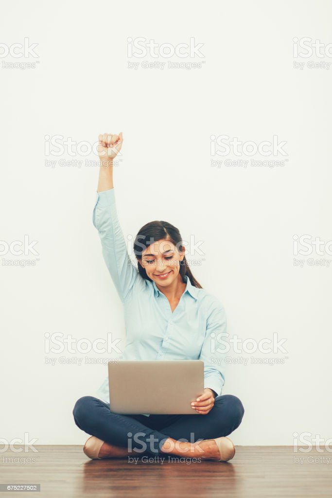 Happy Young Beautiful Woman on Floor with Laptop royalty-free stock photo
