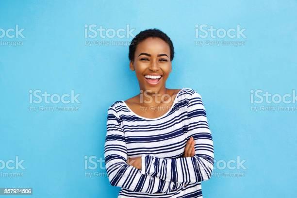 Happy young black woman laughing against blue wall picture id857924506?b=1&k=6&m=857924506&s=612x612&h=r ngzd0rgyxjsw2uffdiv78fxpwxuavrjk1vb0efjny=