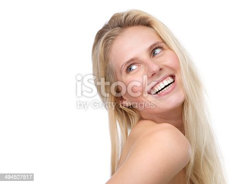 673361134 istock photo happy young blond woman smiling 494527517