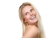 istock happy young blond woman smiling 494527517