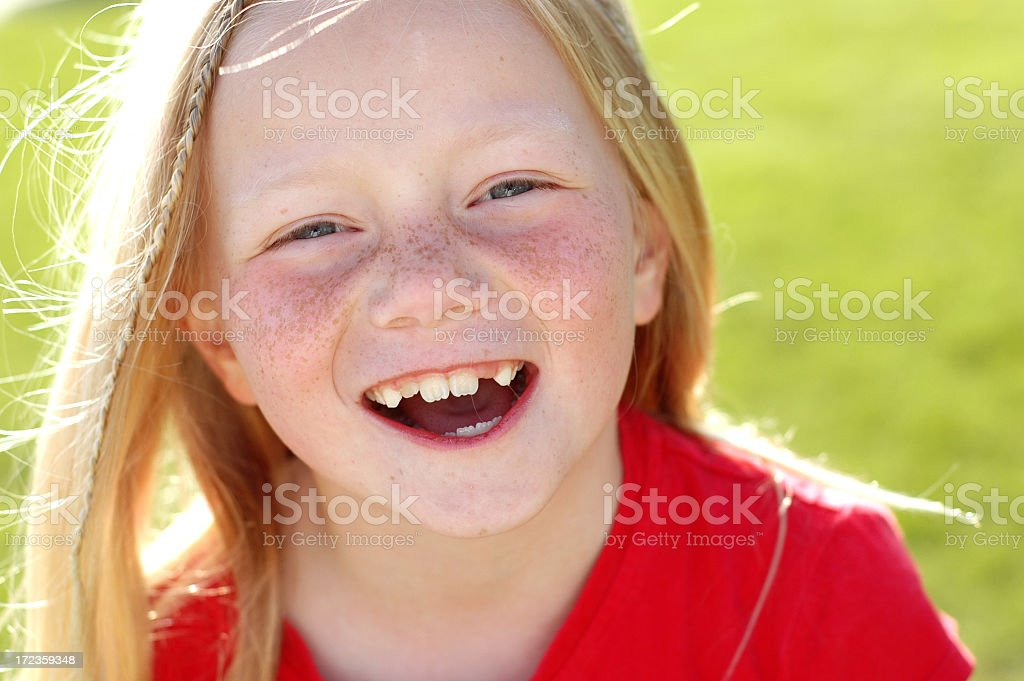 Happy Young Blonde Girl Laughing Outside royalty-free stock photo
