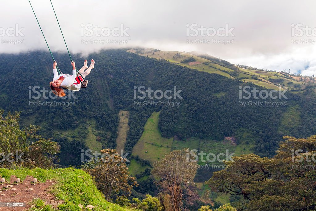 Happy Young Blonde Woman Swinging stock photo