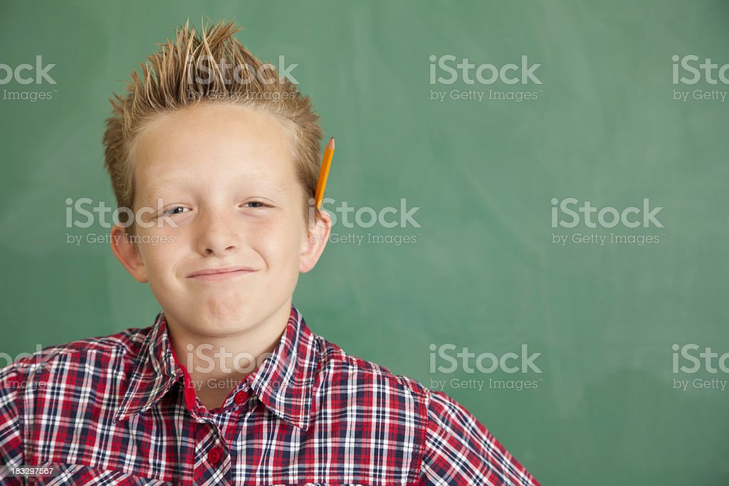 Happy Young Boy at School In Front of Chalkboard royalty-free stock photo