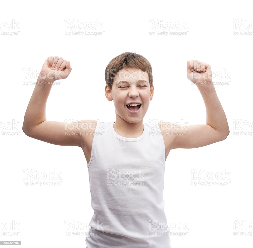 Happy young boy in a sleeveless shirt stock photo