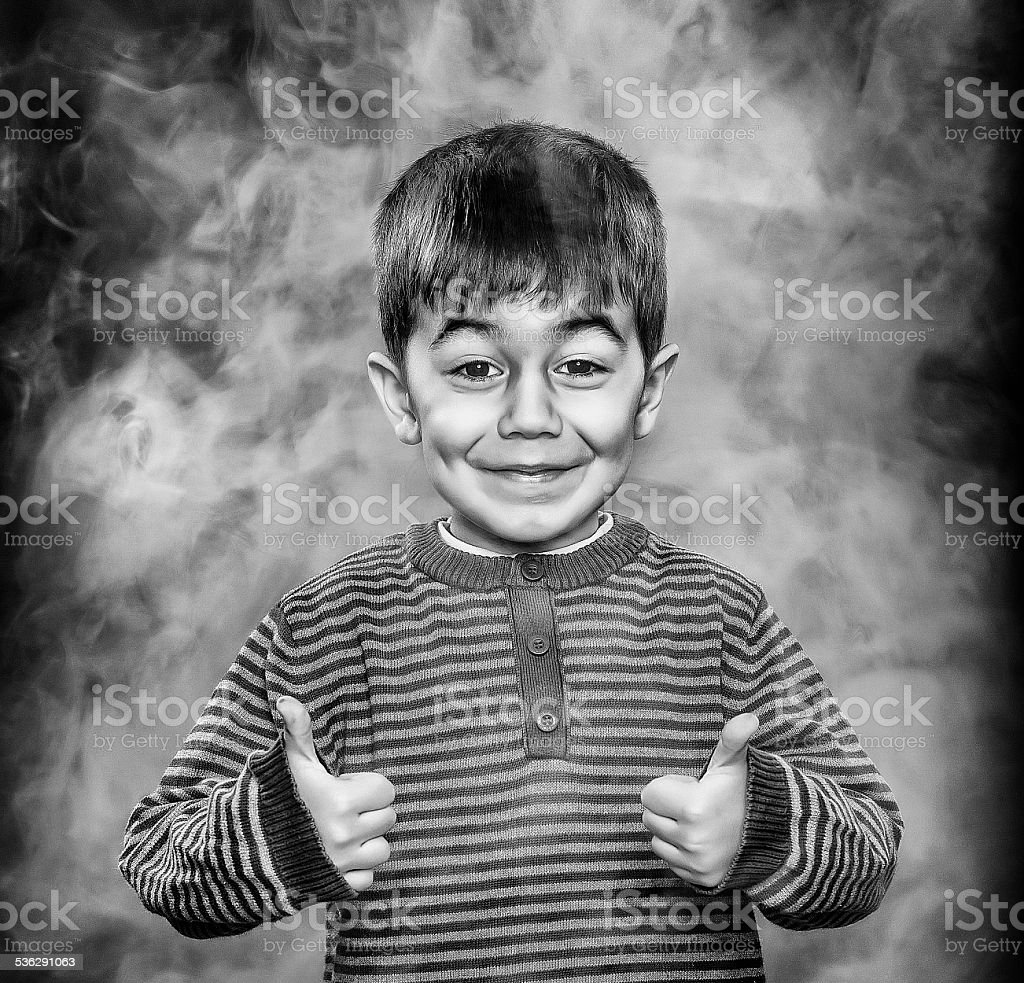happy young boy in smoke stock photo