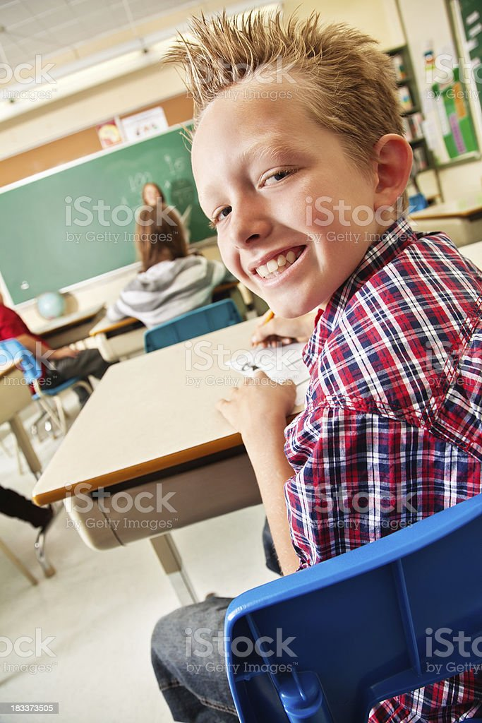 Happy Young Boy Looking Back During Class royalty-free stock photo