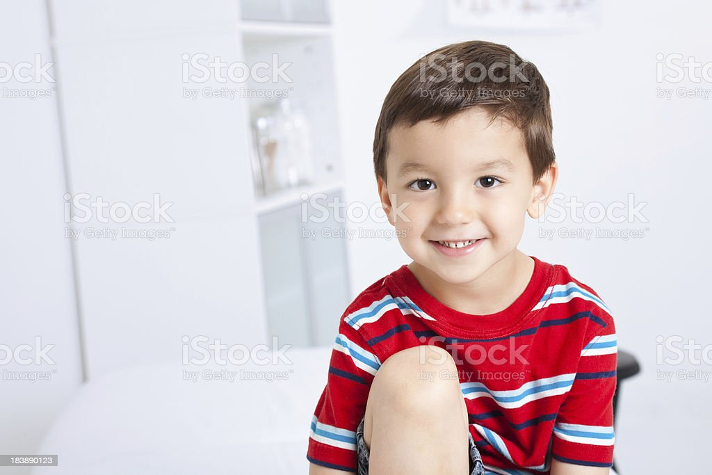 Happy Young Boy Sitting In Doctor's Office royalty-free stock photo