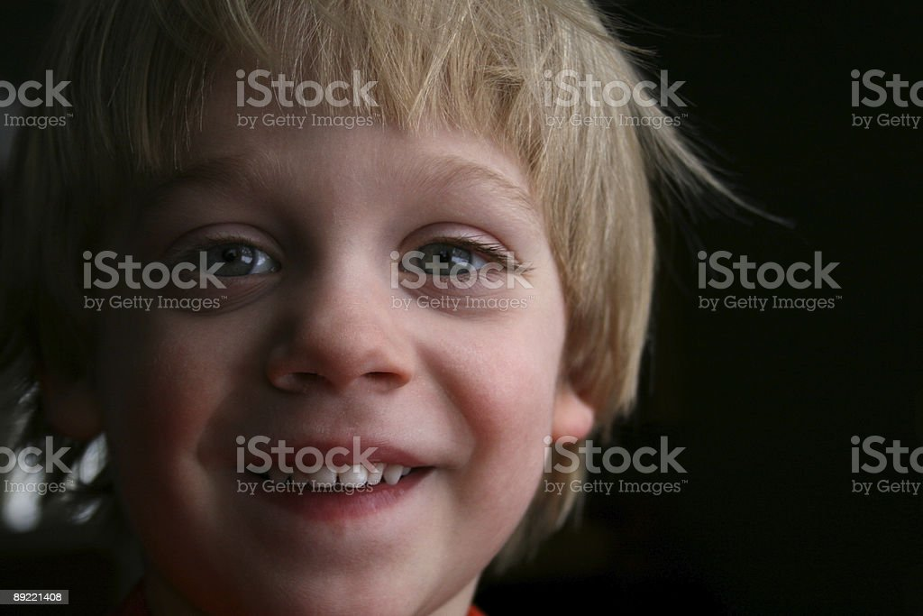 Happy Young Boy Smiling Brightly stock photo