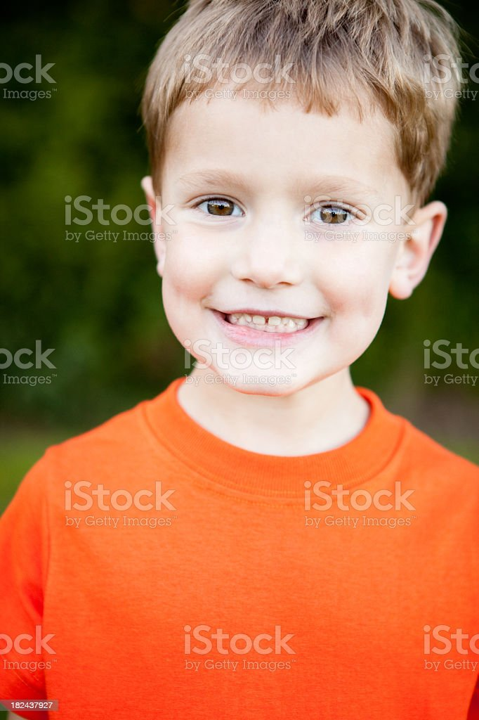 Happy Young Boy Smiling Outside royalty-free stock photo