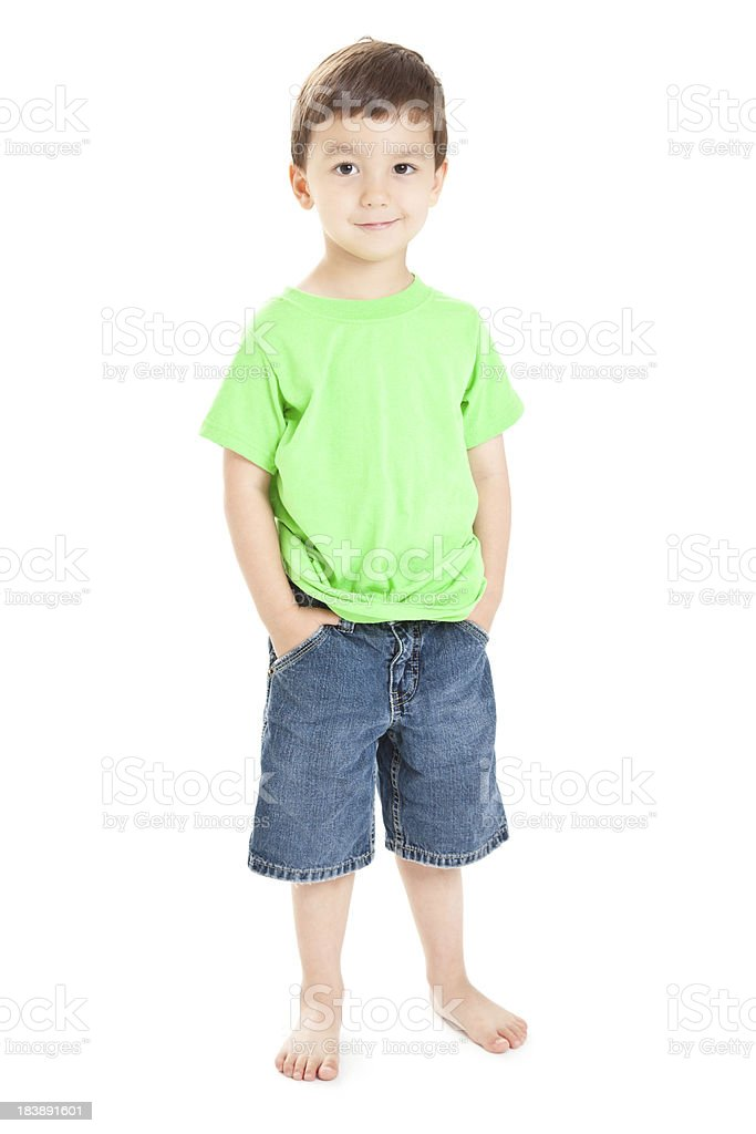 Happy Young Boy Standing With Hands in Pockets, White Background stock photo