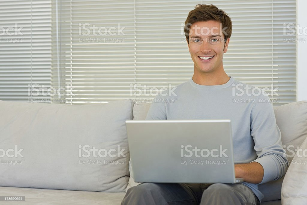 Happy young boy using laptop royalty-free stock photo
