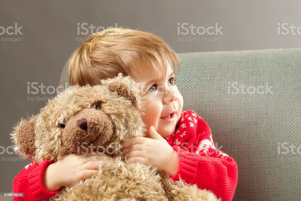 Happy Young Boy with Teddy Bear stock photo