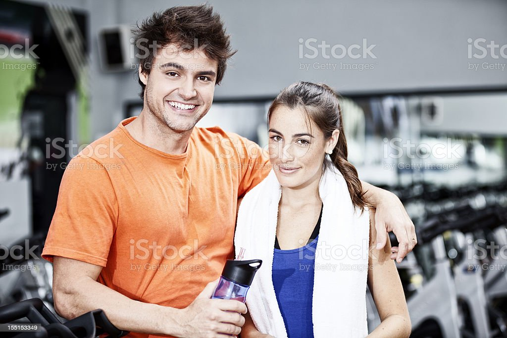 Happy young Brazilian couple in a gym royalty-free stock photo