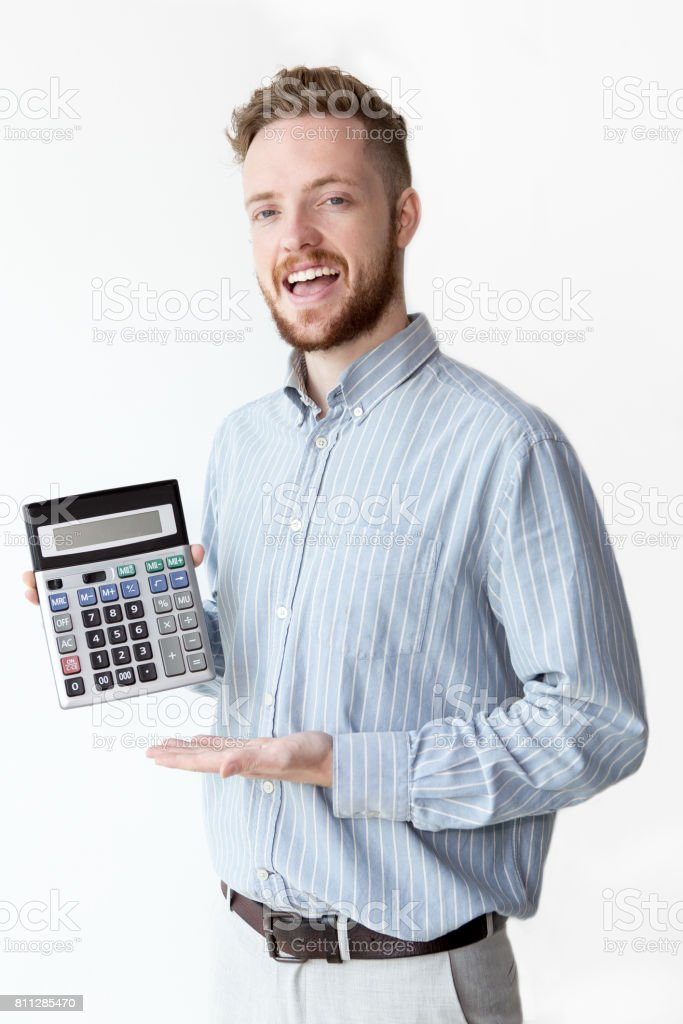 Happy young broker showing profit on calculator stock photo
