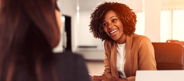 Happy young busiensswoman at the meeting stock photo