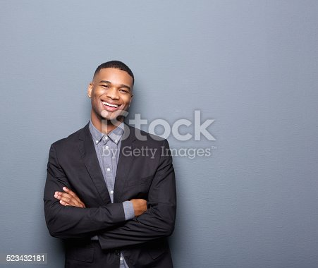 825083570 istock photo Happy young business man smiling with arms crossed 523432181