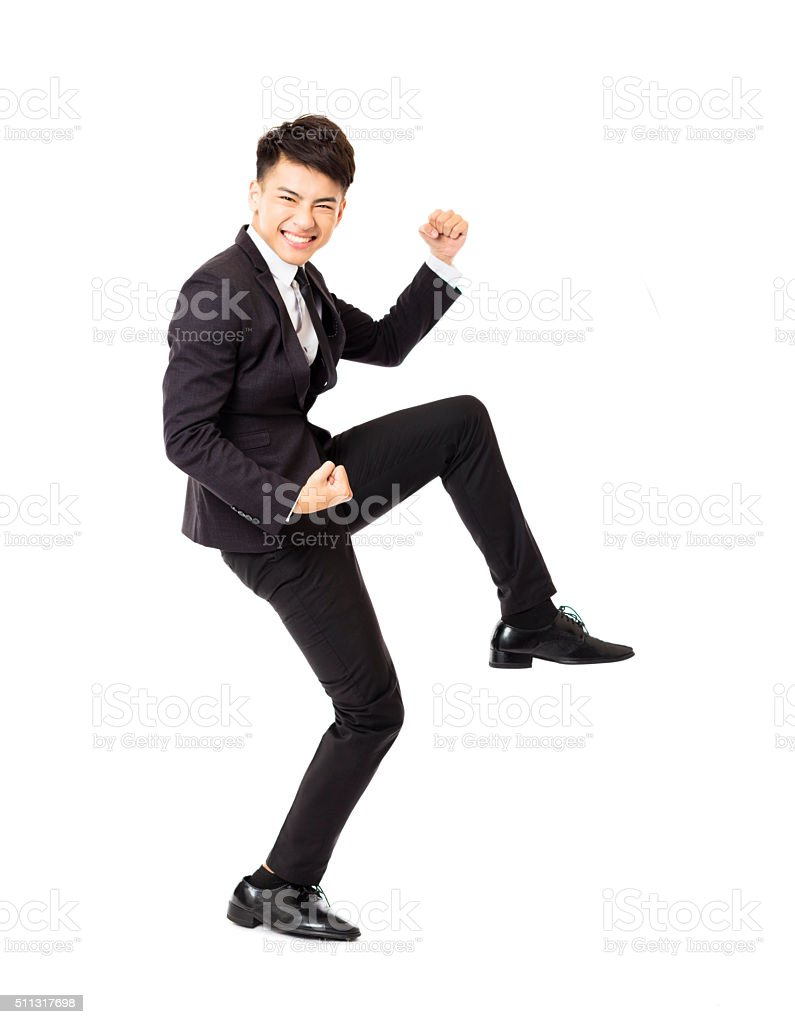 happy  young business man with successful gesture stock photo