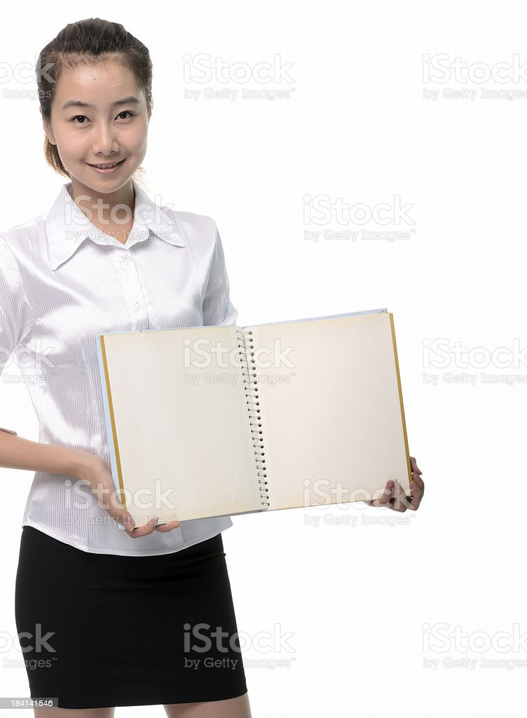 Happy young business woman holding a blank book stock photo