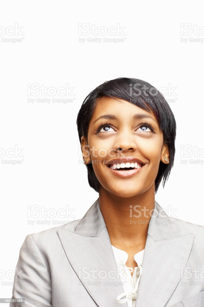 Happy young business woman looking up against white royalty-free stock photo