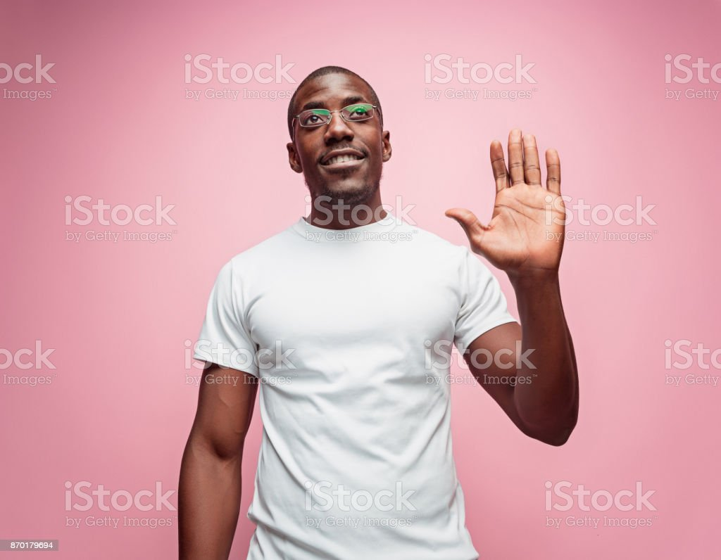 Happy Young Businessman Extending Hand To Shake stock photo